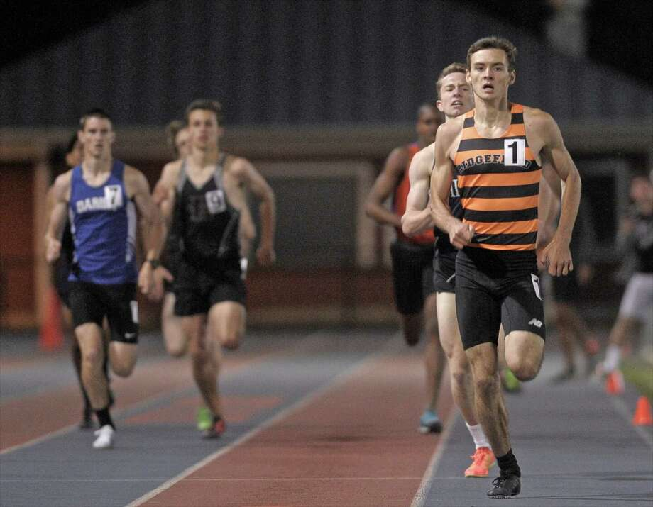 Johnathan Keating, from Ridgefield High School, leads the pack to the finish line of the boys 800 meter run at the 2015 Dream Invitational track meet held at Danbury High School, on Friday night, May 15, 2015, in Danbury, Conn. Keating won with a time of 1:56:42. Photo: H John Voorhees III / The News-Times