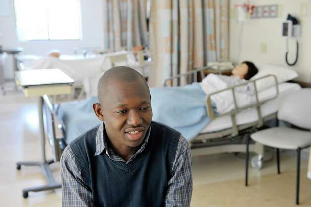 Douglas A. Ayombisa, a nursing student at  Belanger School of Nursing/Ellis, talks about his life during an interview on Thursday, May 14, 2015, in Schenectady, N.Y.  Ayombisa, who came over from Africa to start his career in nursing, will graduate Friday.  (Paul Buckowski / Times Union) Photo: PAUL BUCKOWSKI / 00031800A