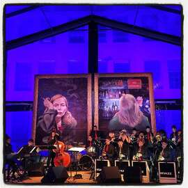 The SFJazz High School All-Stars play beneath a self-portrait album cover by Joni Mitchell in the Stanlee Gatti-designed dinner tent. May 2015. By Catherine Bigelow.
