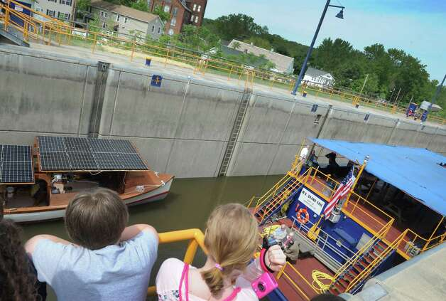Students from St. Mary's Catholic School of Waterford watch as boats enter Lock E2  during a 100th Anniversary celebration of the opening of the Waterford flight of locks and the seasonal opening of the canal system on Friday May 15, 2015 in Waterford, N.Y. (Michael P. Farrell/Times Union) Photo: Michael P. Farrell / 00031858A