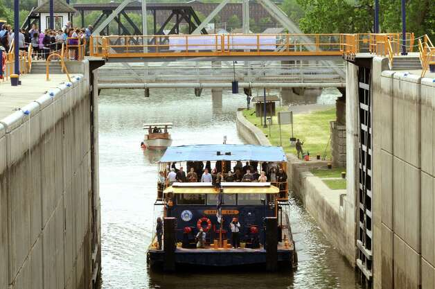 The tug Grand Erie enters Lock E2 during a 100th Anniversary celebration of the opening of the Waterford flight of locks and the seasonal opening of the canal system on Friday May 15, 2015 in Waterford, N.Y. (Michael P. Farrell/Times Union) Photo: Michael P. Farrell / 00031858A