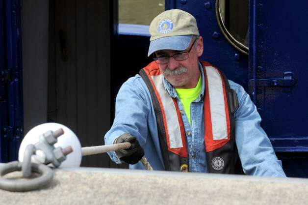 Mike Pelletier engineer of the tug Urger moor his boat at Lock E2 during a 100th Anniversary celebration of the opening of the Waterford flight of locks and the seasonal opening of the canal system on Friday May 15, 2015 in Waterford, N.Y. (Michael P. Farrell/Times Union) Photo: Michael P. Farrell / 00031858A