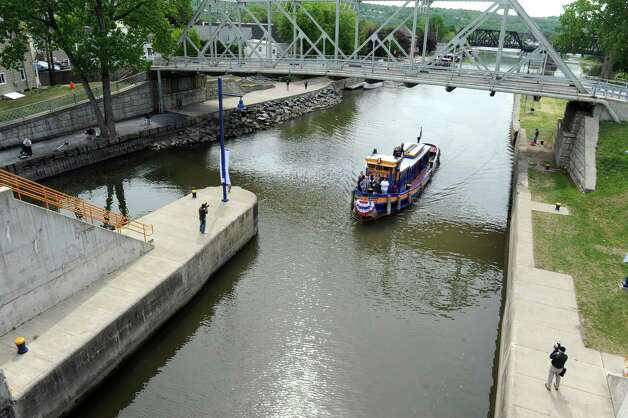 The tug Urger enters Lock E2 during a 100th Anniversary celebration of the opening of the Waterford flight of locks and the seasonal opening of the canal system on Friday May 15, 2015 in Waterford, N.Y. (Michael P. Farrell/Times Union) Photo: Michael P. Farrell / 00031858A