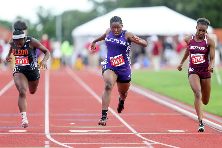 Brackenridge's Tevis Thomas (center) crosses the finish line of the 5A 100-meter dash between Lockhart'sShanice Manning (right) and Aledo's Mikia Jordan during the UIL State track and field meet at Mike Myers Stadium in Austin on Friday, May 15, 2015. Thomas took third place in the event with a time of 11.93 seconds. MARVIN PFEIFFER/ mpfeiffer@express-news.net Photo: Photos By Marvin Pfeiffer / San Antonio Express-News / Express-News 2015