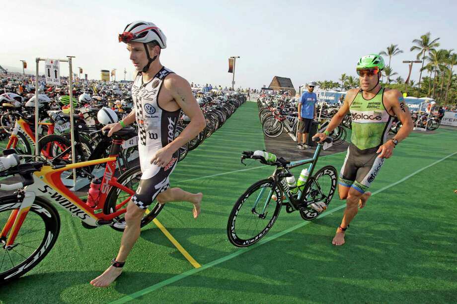 Ben Hoffman, left, finished 15th at the Ironman World Championship Triathlon in 2013. Heading into Saturday's Ironman Texas he's ready for his attempt at first place. Photo: Chris Stewart, FRE / FR64731 AP