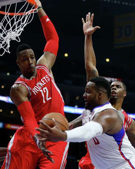 Dwight Howard, left, was a formidable force inside against Glen Davis and his Clippers cohorts in Game 6, collecting 21 rebounds, two blocks and one steal. Photo: James Nielsen, Staff / © 2015  Houston Chronicle