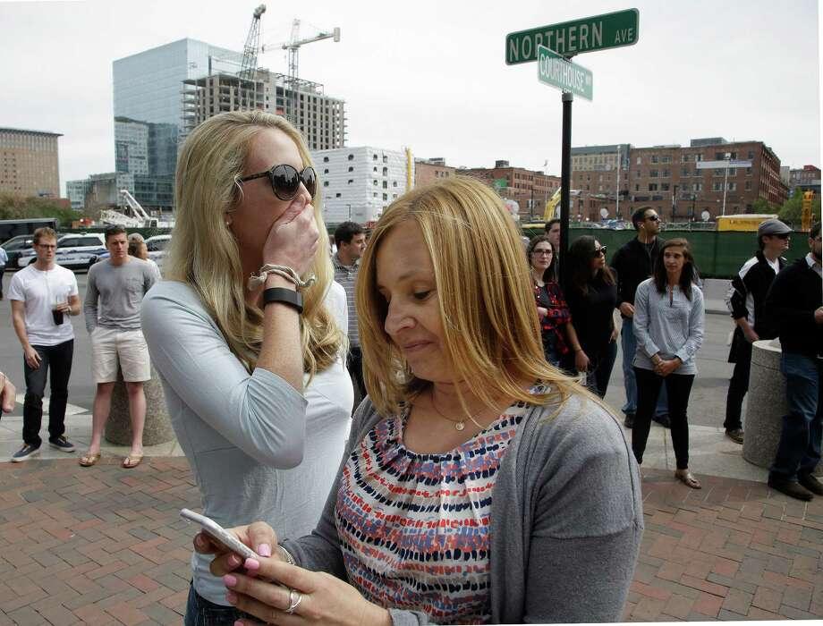 Kathryn Vanwie (left) and Karen Snyder get word of Dzhokhar Tsarnaev's punishment near the courthouse in Boston. Photo: Stephan Savoia /Associated Press / AP