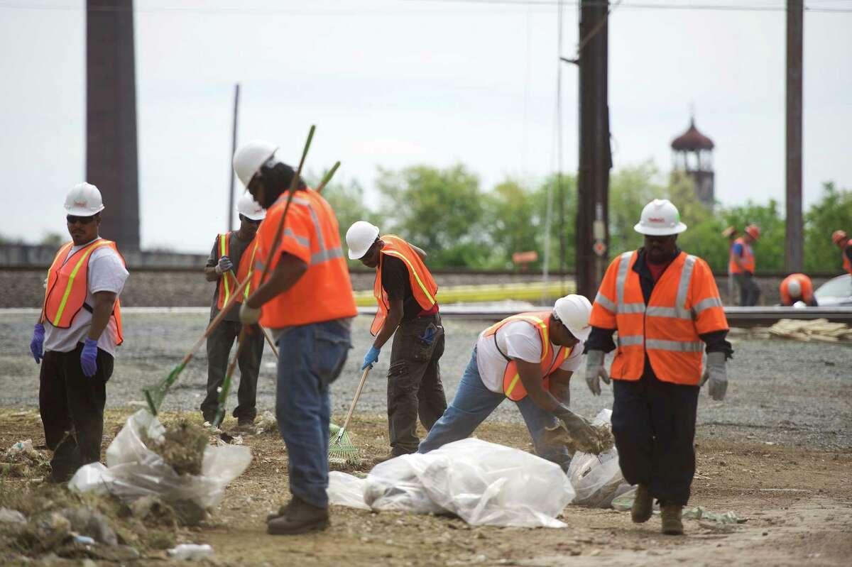 Crews rake debris at the site of the Amtrak passenger train derailment on May 15, 2015, in Philadelphia, Pennsylvania.
