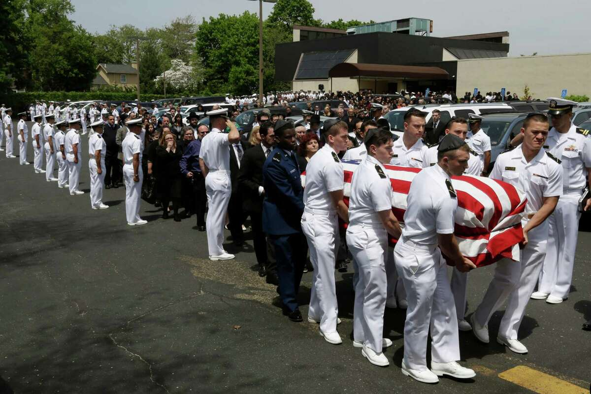 A funeral is held in Hewlett, N.Y., for Naval Academy midshipman Justin Zemser, who died in the Philadelphia derailment. His was the first funeral for any of the eight people killed in the crash.