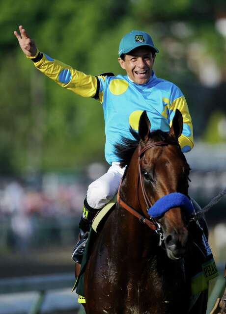Victor Espinoza reacts after riding American Pharoah to victory in the 141st running of the Kentucky Derby horse race at Churchill Downs Saturday, May 2, 2015, in Louisville, Ky.  (AP Photo/Matt Slocum) Photo: Matt Slocum, STF / AP