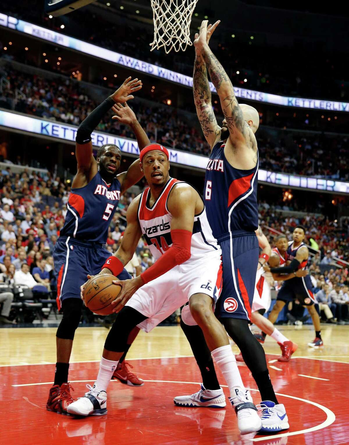 Washington Wizards forward Paul Pierce (34) looks to pass as he is guarded by Atlanta Hawks forwards DeMarre Carroll (5) and Pero Antic (6), from Macedonia, in the first half of Game 6 of the second round of the NBA basketball playoffs, Friday, May 15, 2015, in Washington. (AP Photo/Alex Brandon) ORG XMIT: VZN102