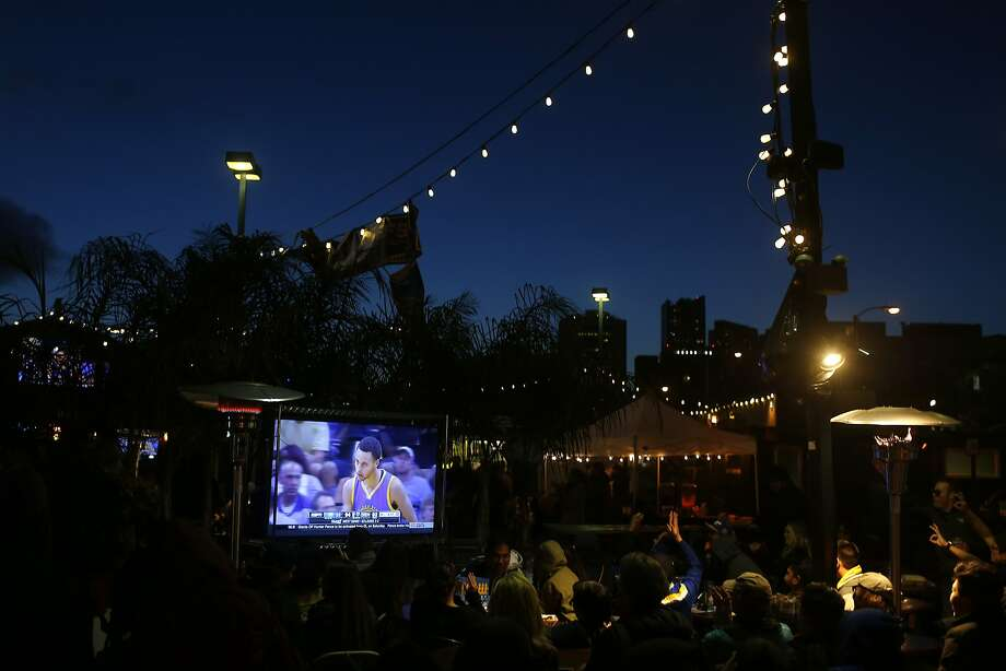 Fans watch Game 7 of the semi-finals game between the Golden State Warriors and the Memphis Grizzlies during a Warriors Community Foundation official Warriors Watch Party at the SOMA StrEat Food Park on Friday, May 15, 2015 in San Francisco, Calif. Photo: Beck Diefenbach, Special To The Chronicle