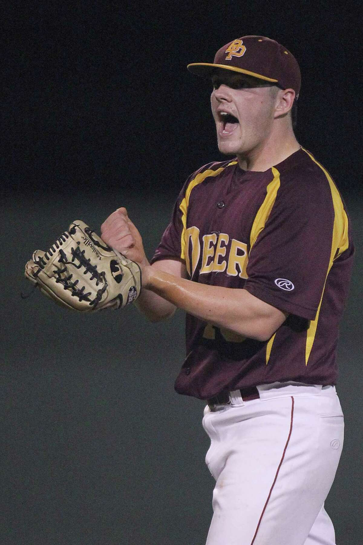 Deer Park's Tyler Smith is upset after hitting Friendswood's Jacob Gwynne with the bases loaded to force in the Mustangs' only run of the game.