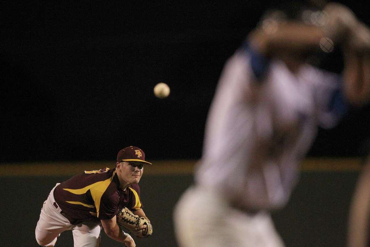 Deer Park's pitcher Tyler Smith (13) pitches to Friendswood's Connor Whitaker (17) in the top of the second inning in a playoff baseball game on Friday, May 15, 2015 in Pearland, TX.