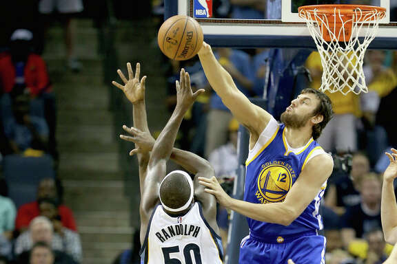 Andrew Bogut, shown blocking Zach Randolph's shot, says the team takes losing streaks seriously.