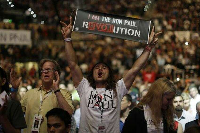 Vreth Liberty Zatikyan from Santa Monica, Calif., shows his support for Rep. Ron Paul, R-Texas, during a rally at the University of South Florida Sun Dome