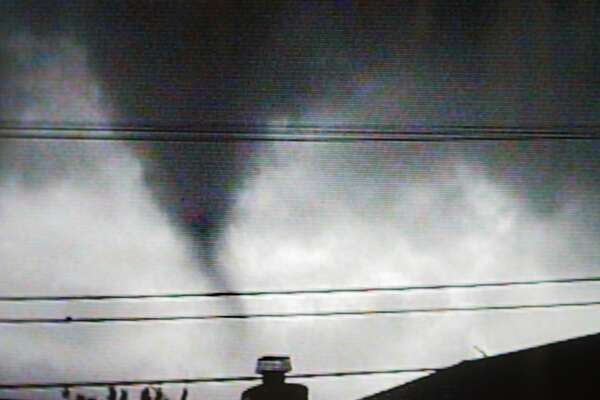 From the 2005 South San Francisco tornado: Amateur video of tornado that came through a neighborhood in South San Francisco. This image taken by a video camera shows the rare funnel cloud as it makes its approach to South San Francisco.