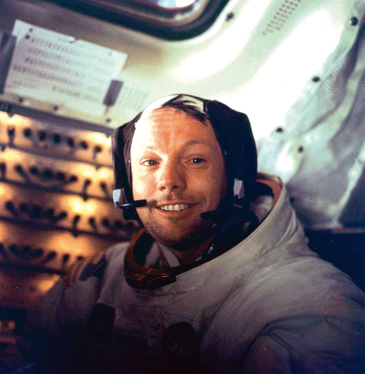 """Apollo 11 space mission US astronaut Neil Armstrong is seen smiling at the camera aboard the lunar module """"Eagle"""" on July 21, 1969 after spending more than 2½ hours on the lunar surface."""