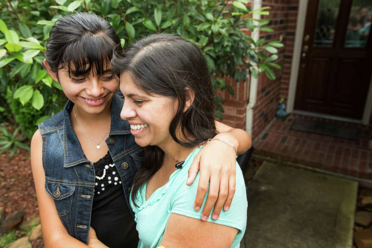 Alondra Diaz, 13, and her mother, Dorotea Garcia, embrace after after Diaz was returned to the United States, following an 8-year cross-border custody case, on Saturday, May 16, 2015, in Houston. Diaz was returned to her mother Friday and was flown to Houston, after she was taken to Mexico in 2007 by her father, Reynaldo Diaz, without her mother's consent, and her whereabouts had not been known until recently.