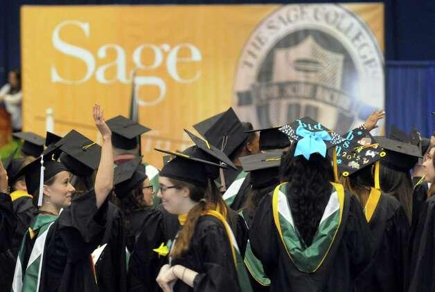 Graduates get to their seats during the Sage Colleges Commencement at the RPI Field House on Saturday May 16, 2015 in Troy, N.Y. (Michael P. Farrell/Times Union) Photo: Michael P. Farrell / 00031510A