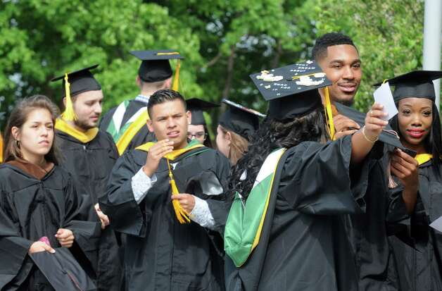 Graduates gather to process during the Sage Colleges Commencement at the RPI Field House on Saturday May 16, 2015 in Troy, N.Y. (Michael P. Farrell/Times Union) Photo: Michael P. Farrell / 00031510A