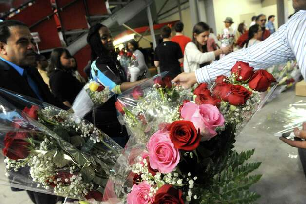 Commencement Bouquets sells flowers during the Sage Colleges Commencement at the RPI Field House on Saturday May 16, 2015 in Troy, N.Y. (Michael P. Farrell/Times Union) Photo: Michael P. Farrell / 00031510A