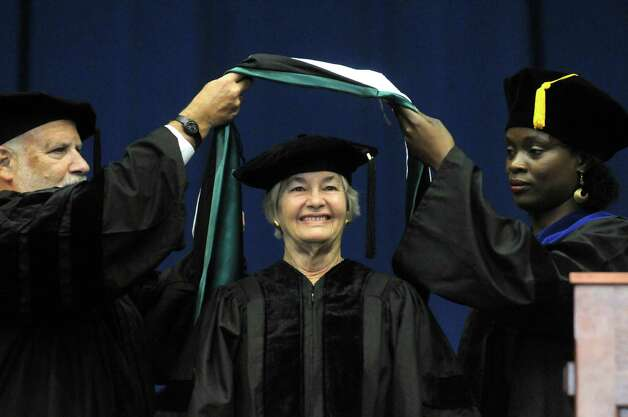 Nancy Mueller receives and honorary degree during the Sage Colleges Commencement at the RPI Field House on Saturday May 16, 2015 in Troy, N.Y. (Michael P. Farrell/Times Union) Photo: Michael P. Farrell / 00031510A