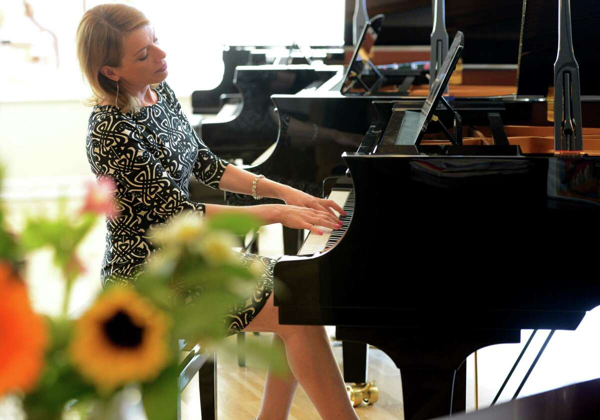 Erica vanderLinde Feidner plays one of the Yamaha grand pianos at Faust Harrison Pianos' new store in Fairfield, Conn.