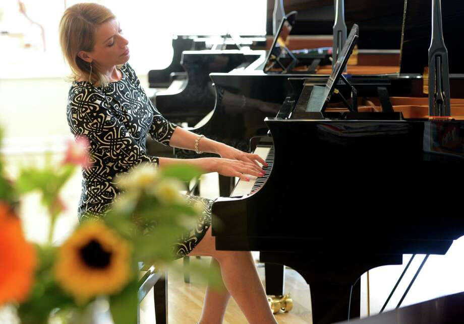 Erica vanderLinde Feidner plays one of the Yamaha grand pianos at Faust Harrison Pianos' new store in Fairfield, Conn. Photo: Autumn Driscoll / Connecticut Post