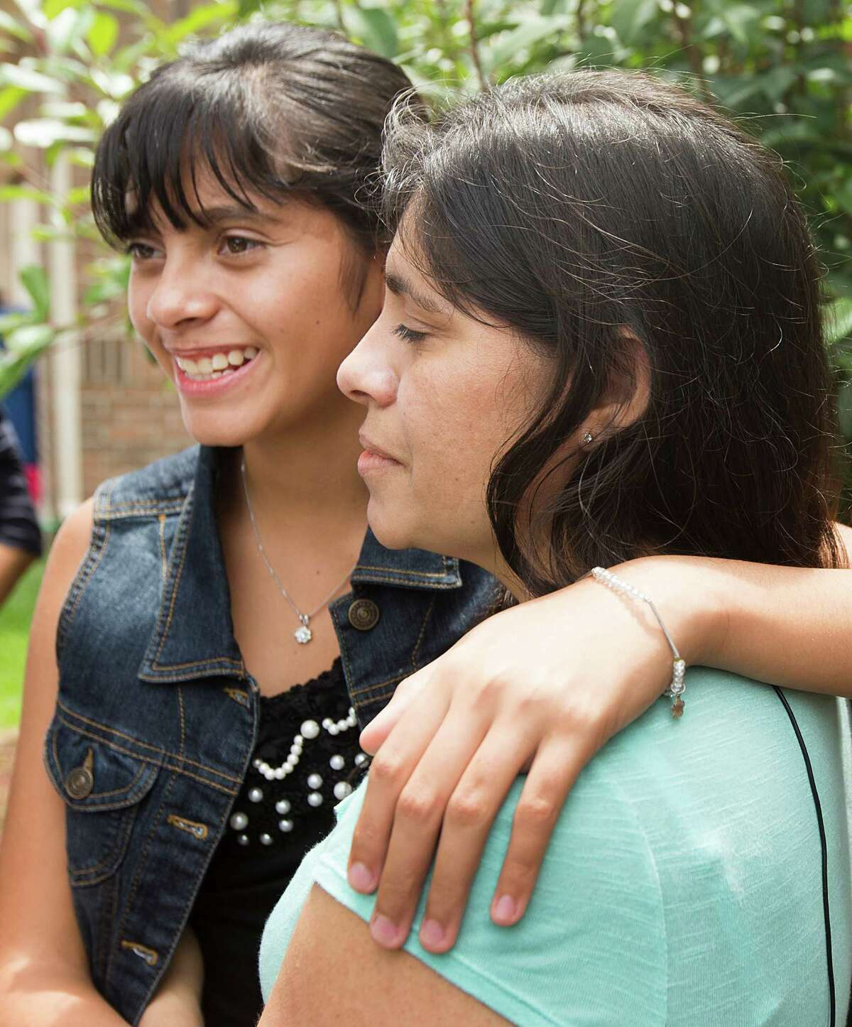 Alondra Diaz, 13, embraces her mother, Dorotea Garcia, after returning to the United States, following an 8-year cross-border custody case, on Saturday, May 16, 2015, in Fresno, Texas. Diaz was returned to her mother Friday and was flown to Houston, after she was taken to Mexico in 2007 by her father, Reynaldo Diaz, without her mother's consent, and her whereabouts had not been known until recently.