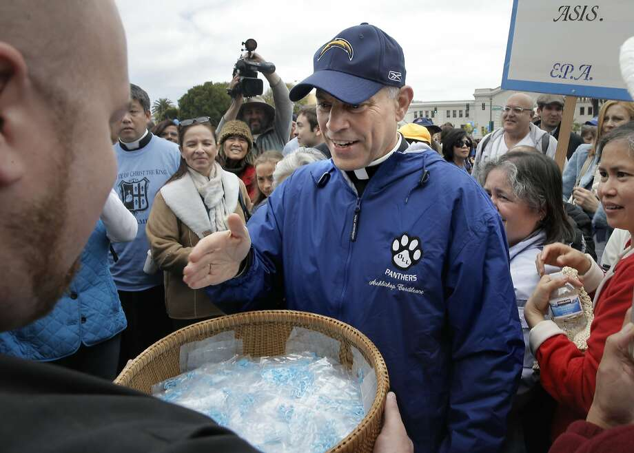 San Francisco Archbishop Cordileone blesses a basket of rosaries before the hundreds gathered to show support for him during a picnic at the Sue Bierman Park along the Embarcadero as seen on Sat. May 16, 2015, in San Francisco, Calif. Photo: Michael Macor, The Chronicle