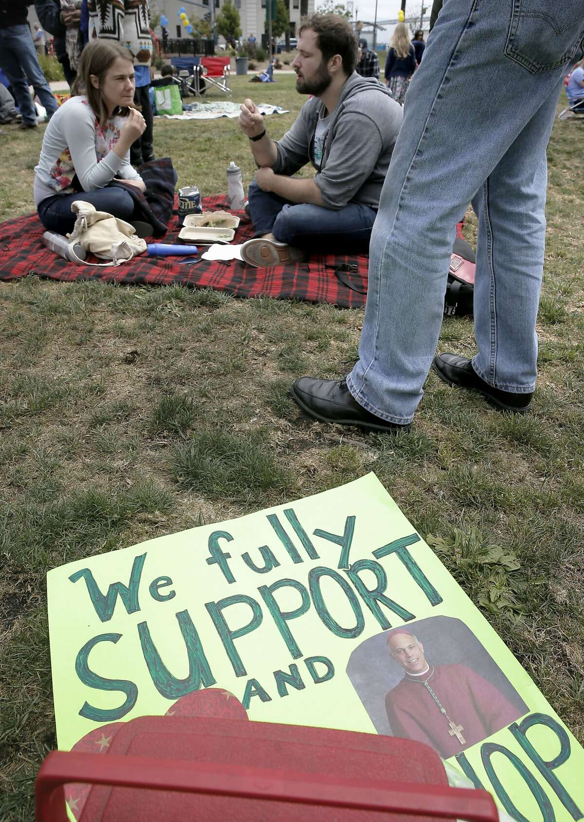 Maria Sitzman, of San Rafael and Blake Landry, of New Orleans joined the gathered crowd to show support for San Francisco Archbishop Cordileone during a picnic at the Sue Bierman Park along the Embarcadero as seen on Sat. May 16, 2015, in San Francisco, Calif.