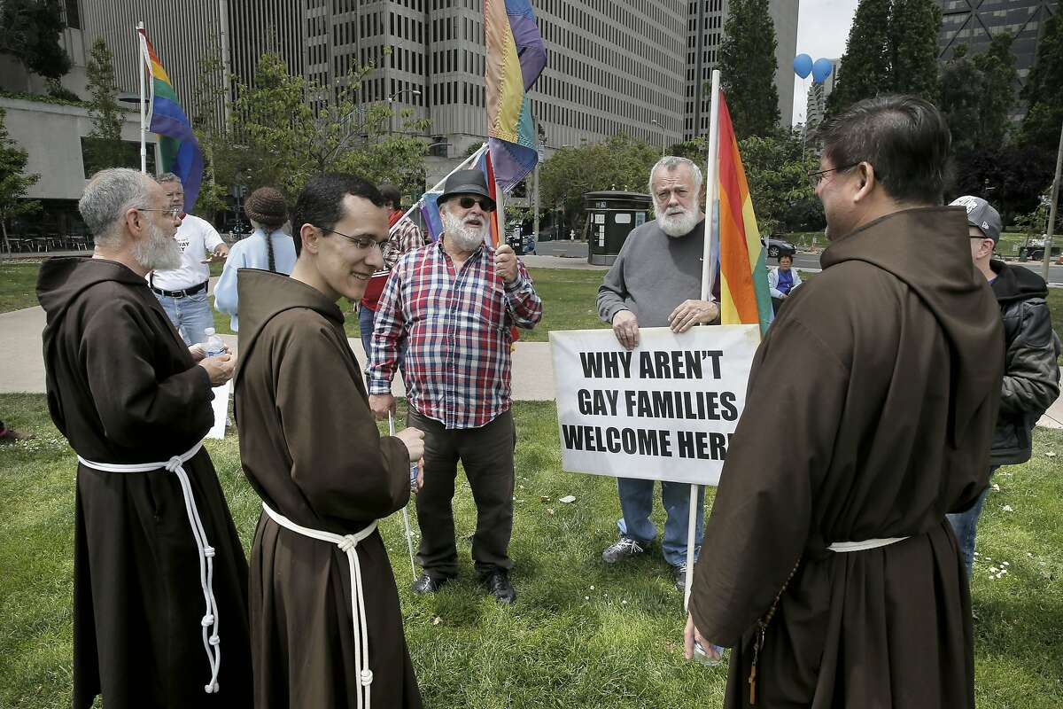 Gay rights supporters Frank Morris, (eft) and Jim Boyd talk with Brother Pete Ciolino, (left) Brother Alex Rodriguez and father John DeLa Riva during the vist by San Francisco Archbishop Cordileone at a picnic showing support for the Archbishop, at the Sue Bierman Park along the Embarcadero as seen on Sat. May 16, 2015, in San Francisco, Calif.