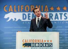 California Lt. Gov. Gavin Newsom introduces U.S. Sen. Elizabeth Warren, D-Mass., at the California Democrats State Convention in Anaheim, Calif., on Saturday, May 16, 2015. (AP Photo/Damian Dovarganes)