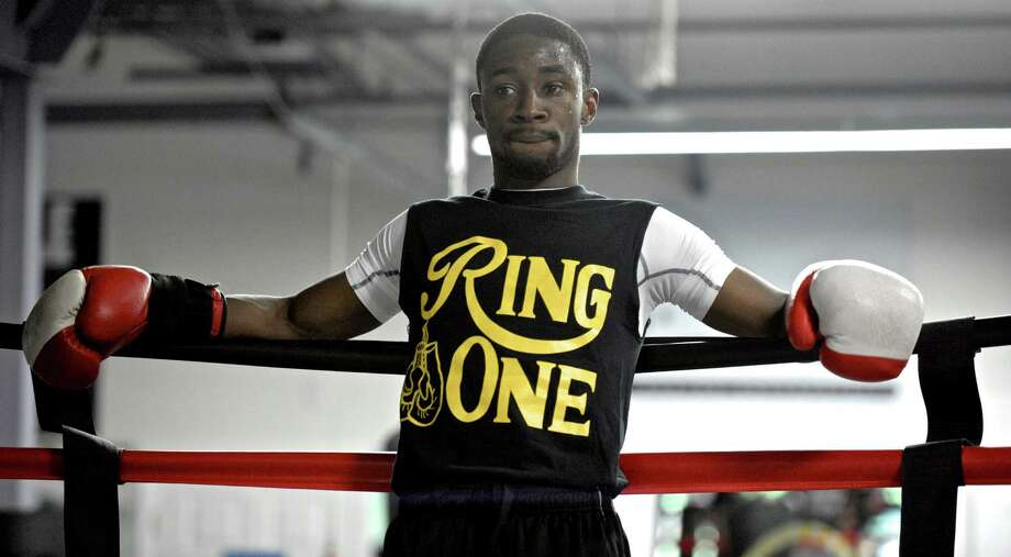 Boxer Tramaine Williams takes a break during a pre-fight public workout at Champs Boxing Club, in Danbury, Conn, on Saturday, May 16, 2015. The workout was for the boxers taking part in Danbury Fight Night, which is being promoted by A.J. Galante. Photo: H John Voorhees III / The News-Times