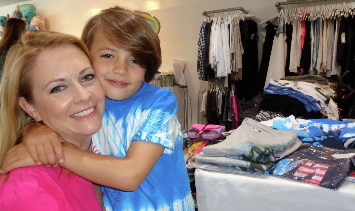 Actress Melissa Joan Hart with her son Braydon, 7, at Groove in Westport, where she hosted a trunk show Saturday to introduce her new boys clothing line, King of Harts.