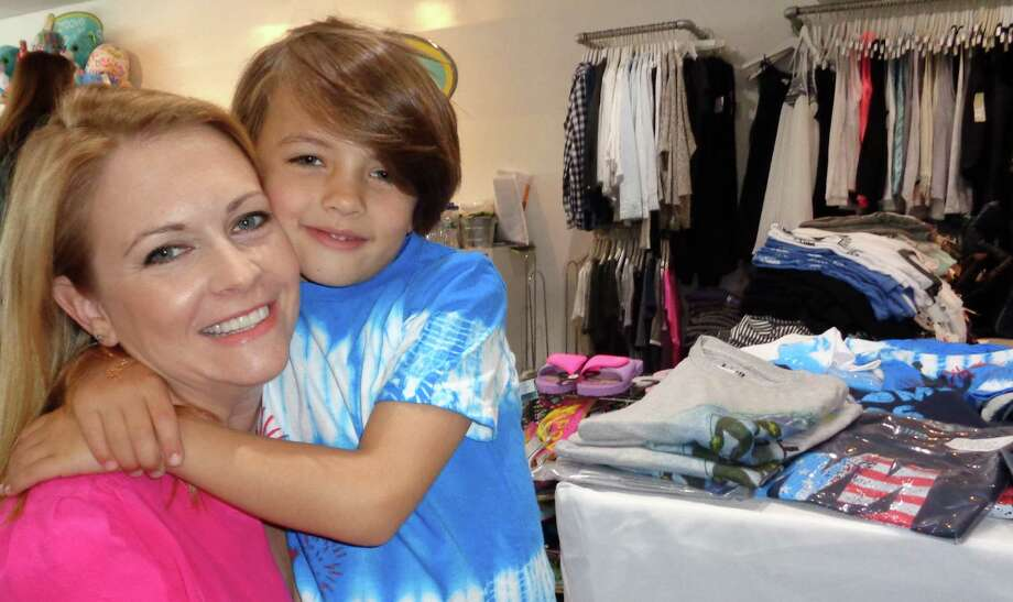 "Actress Melissa Joan Hart with her son Braydon, 7, at Groove in Westport, where she hosted a trunk show Saturday to introduce her new boys clothing line, King of Harts. ""Brady"" is wearing one of the tee-shirts in the new Montauk-themed spring/summer collection, which is carried at Groove and on Hart's website. Photo: Meg Barone / Westport News"