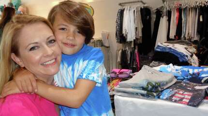 """Actress Melissa Joan Hart with her son Braydon, 7, at Groove in Westport, where she hosted a trunk show Saturday to introduce her new boys clothing line, King of Harts. """"Brady"""" is wearing one of the tee-shirts in the new Montauk-themed spring/summer collection, which is carried at Groove and on Hart's website."""