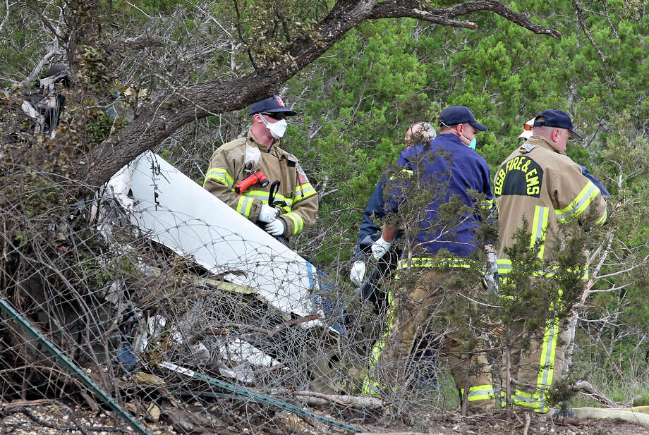A small aircraft crashes into a wooded area adjacent to the back parking lot of Strutty's  Feed and Pet Supply just across Highway 281from Kestrel Air Park in Bulverde on Saturday, May16, 2025.  Several bodies are removed from the scene. Photo: Tom Reel, San Antonio Express-News