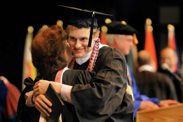 Graduate Connor Grant-Knight, right, celebrates the moment with a faculty member during Skidmore College commencement exercises on Saturday, May 16, 2015, at Saratoga Performing Arts Center in Saratoga Springs, N.Y. (Cindy Schultz / Times Union) Photo: Cindy Schultz / 00031514A