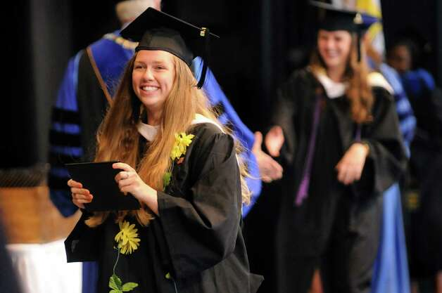 Graduate Juliana O'Brien, left, receives her diploma during Skidmore College commencement exercises on Saturday, May 16, 2015, at Saratoga Performing Arts Center in Saratoga Springs, N.Y. (Cindy Schultz / Times Union) Photo: Cindy Schultz / 00031514A