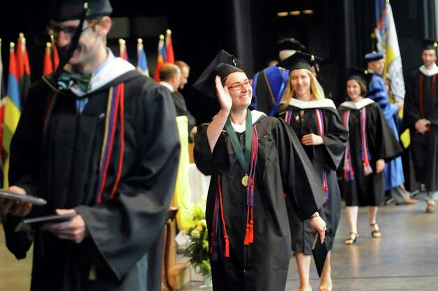 Graduate Sarah Breitenfeld, center, waves from stage during Skidmore College commencement exercises on Saturday, May 16, 2015, at Saratoga Performing Arts Center in Saratoga Springs, N.Y. (Cindy Schultz / Times Union) Photo: Cindy Schultz / 00031514A