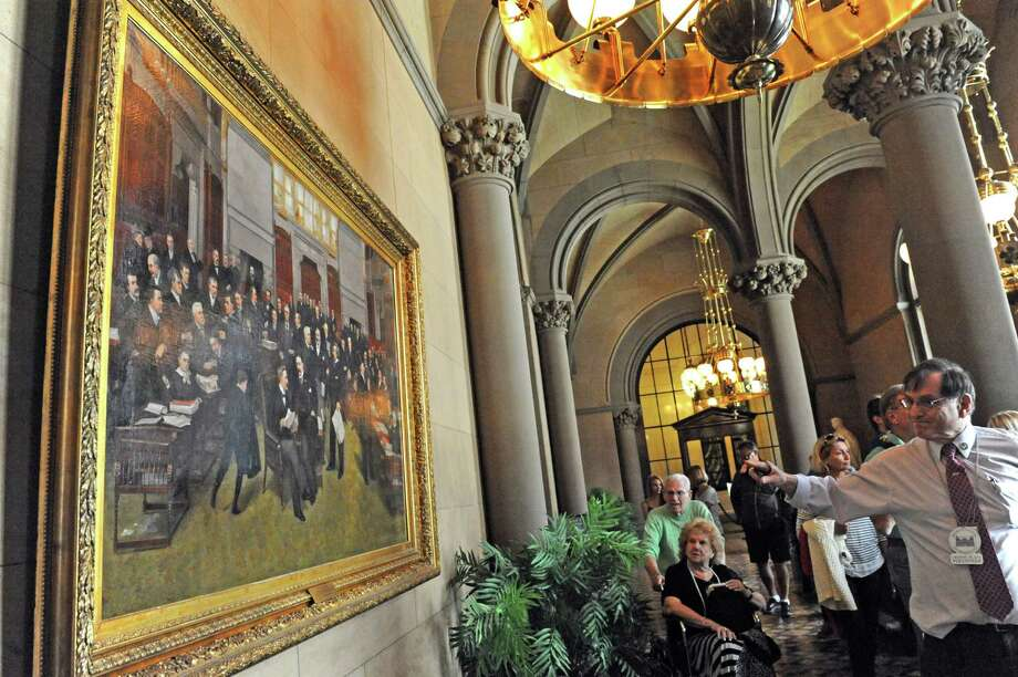 OGS tour guide Hal Learner, left, points to a painting by artist William Bengough of the New York State Senate painted in 1892 during a tour of the Capitol on Thursday May 14, 2015 in Albany, N.Y. (Michael P. Farrell/Times Union) Photo: Michael P. Farrell
