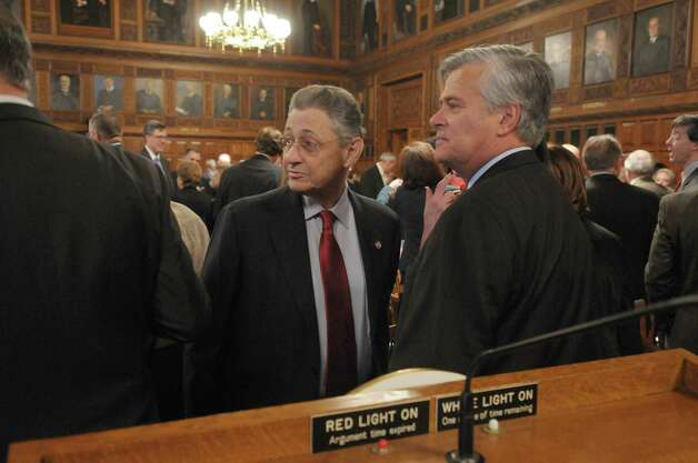 Assembly Speaker  Sheldon Silver, left, and Senate Majority Leader Dean Skelos, right, talk before the start of the State of the Judiciary address at the Court of Appeals on Tuesday, Feb. 14, 2012 in Albany, NY.   (Paul Buckowski / Times Union archive) Photo: Paul Buckowski / 00016425A