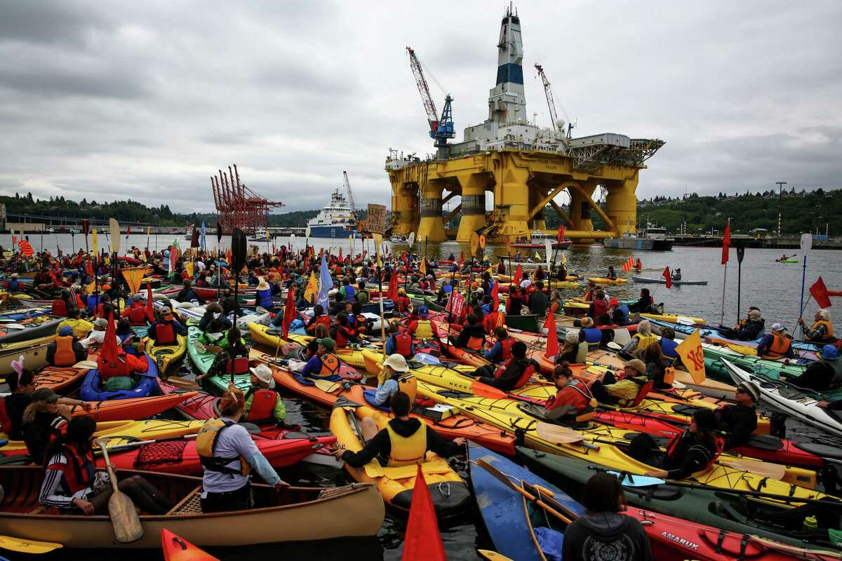 Hundreds of kayaktivists take to the water during protest against drilling in the Arctic and the Port of Seattle being used as a port for the Shell Oil drilling rig Polar Pioneer. The protest flotilla drew many paddlers to show their displeasure with the rig being moored in Seattle. Photographed on Saturday, May 16, 2015.