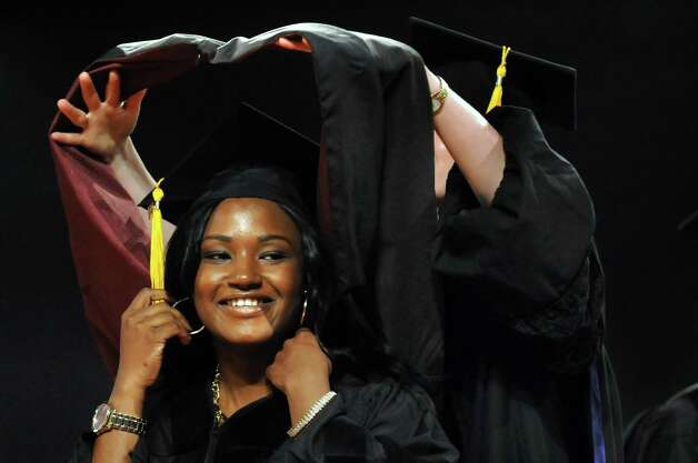Graduate Motunrayo Ogunjemilusi is hooded as Doctor of Pharmacy during the Albany College of Pharmacy commencement exercises on Saturday, May 16, 2015, at the Empire State Plaza Convention Center in Albany, N.Y. (Cindy Schultz / Times Union) Photo: Cindy Schultz / 00031495A