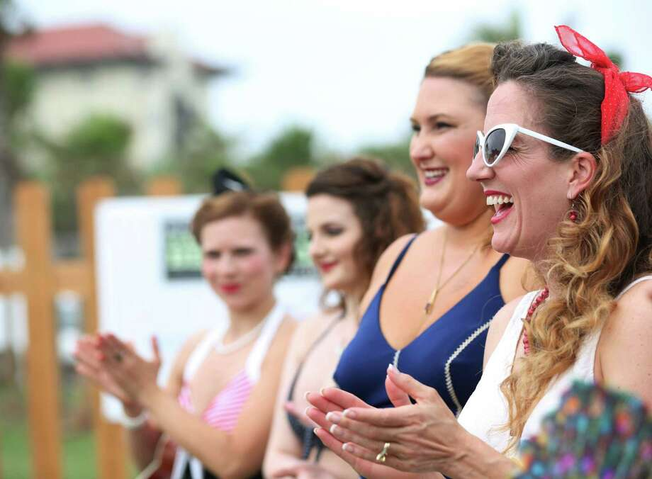 Jody Moss, of Baton Rouge, watches the other contestants during the Bathing Beauties contest at the Galveston Island Beach Revue Saturday, May 16, 2015, in Galveston. Photo: Jon Shapley, Houston Chronicle / © 2015 Houston Chronicle