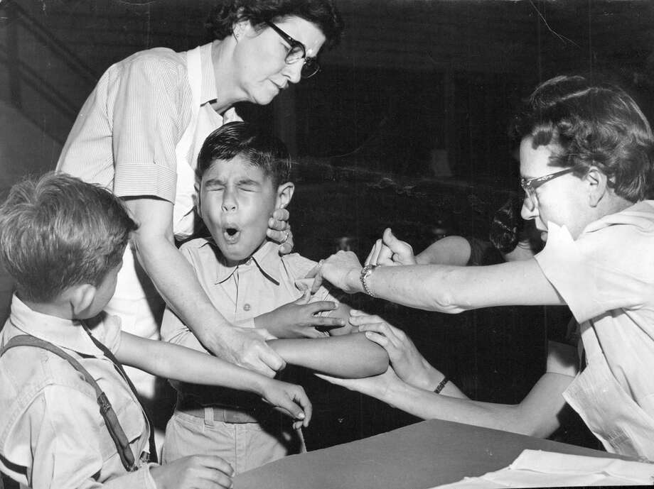 In 1953, Gilbert Sanchez winced as he received a polio vaccination in San Antonio. Photo: File Photo /San Antonio Express-News / San Antonio Express-News