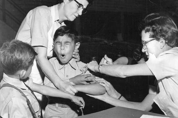 In 1953, Gilbert Sanchez winced as he received a polio vaccination in San Antonio.