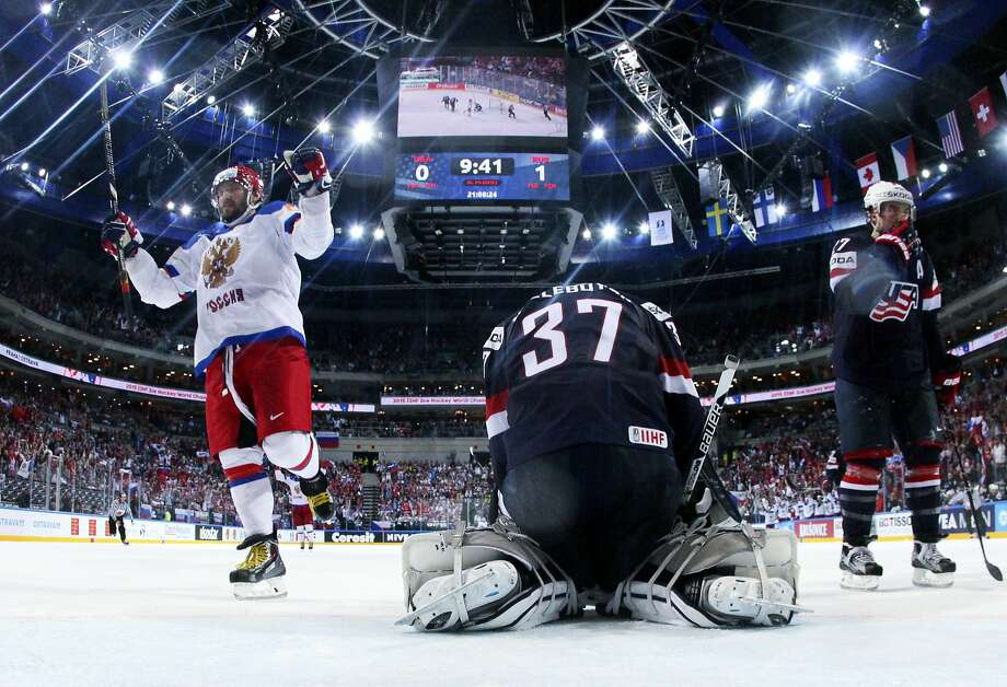 Washington's Alexander Ovechkin (left) celebrates after scoring a goal past goalkeeper Connor Hellebuyck (C) during the semi final match USA vs Russia at the 2015 IIHF Ice Hockey World Championships on May 16, 2015 at the O2 Arena in Prague. AFP PHOTO / POOL / ANDRE RINGUETTEAndre Ringuette/AFP/Getty Images Photo: Andre Ringuette, AFP / Getty Images